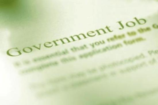 """Piece of paper with the words """"Government Jobs"""" in bold"""