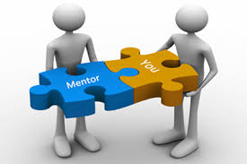 "Picture of two people holding puzzle pieces. One reads ""Mentor,"" and the other reads ""You"""