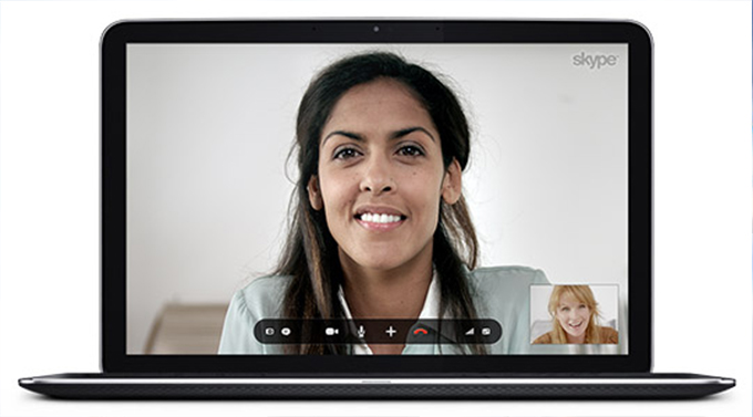 Image of a laptop with a Skype video conference going on between two women.